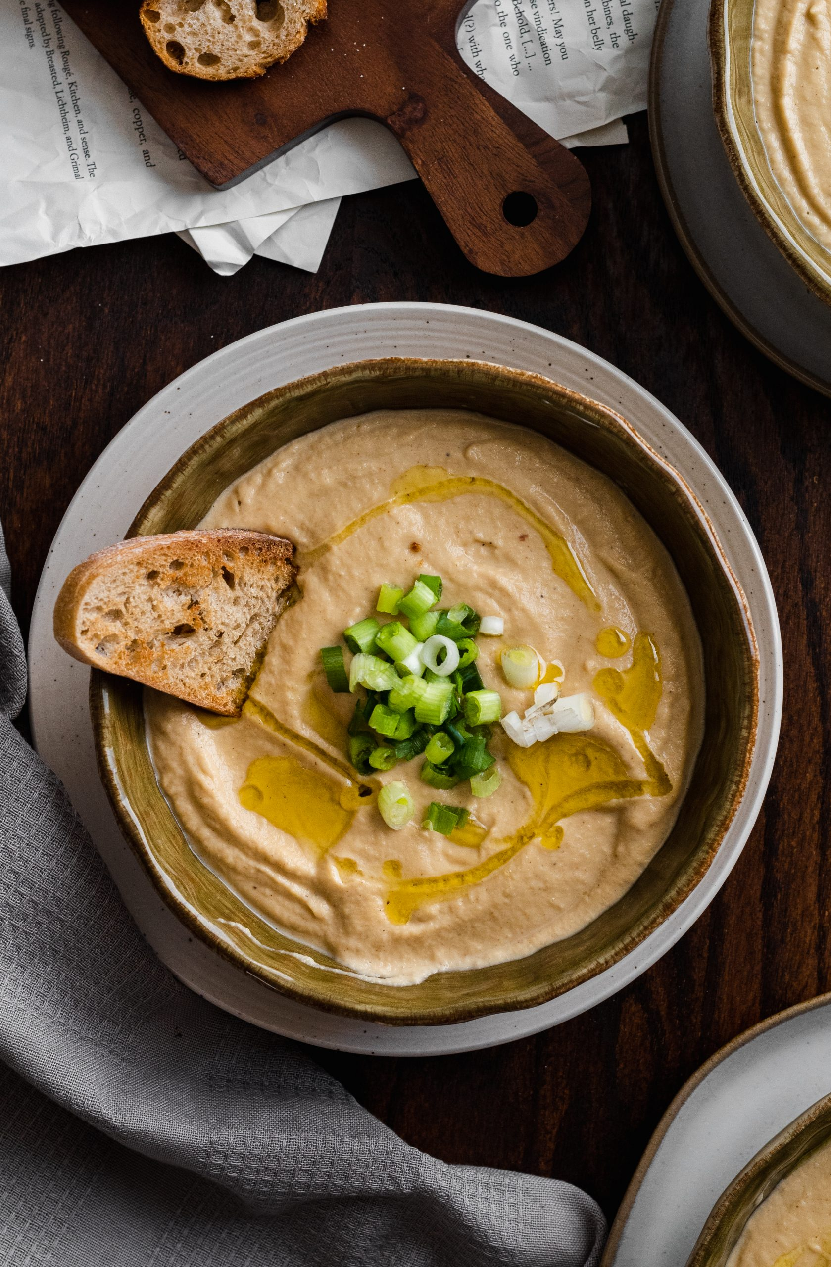 creamy roasted cauliflower soup with onions, garlic, cauliflower, and cashew cream